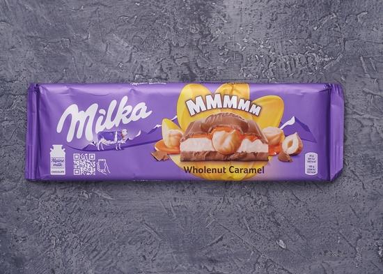 Фото №2 Шоколад Milka Wholenut Caramel 300 г